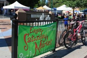 Eagle Saturday Market Sign on Fence in Front of Tents