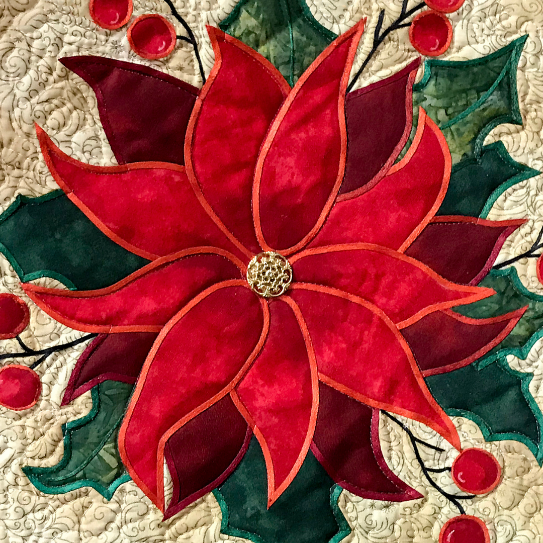 A quilt with a poinsettia design.