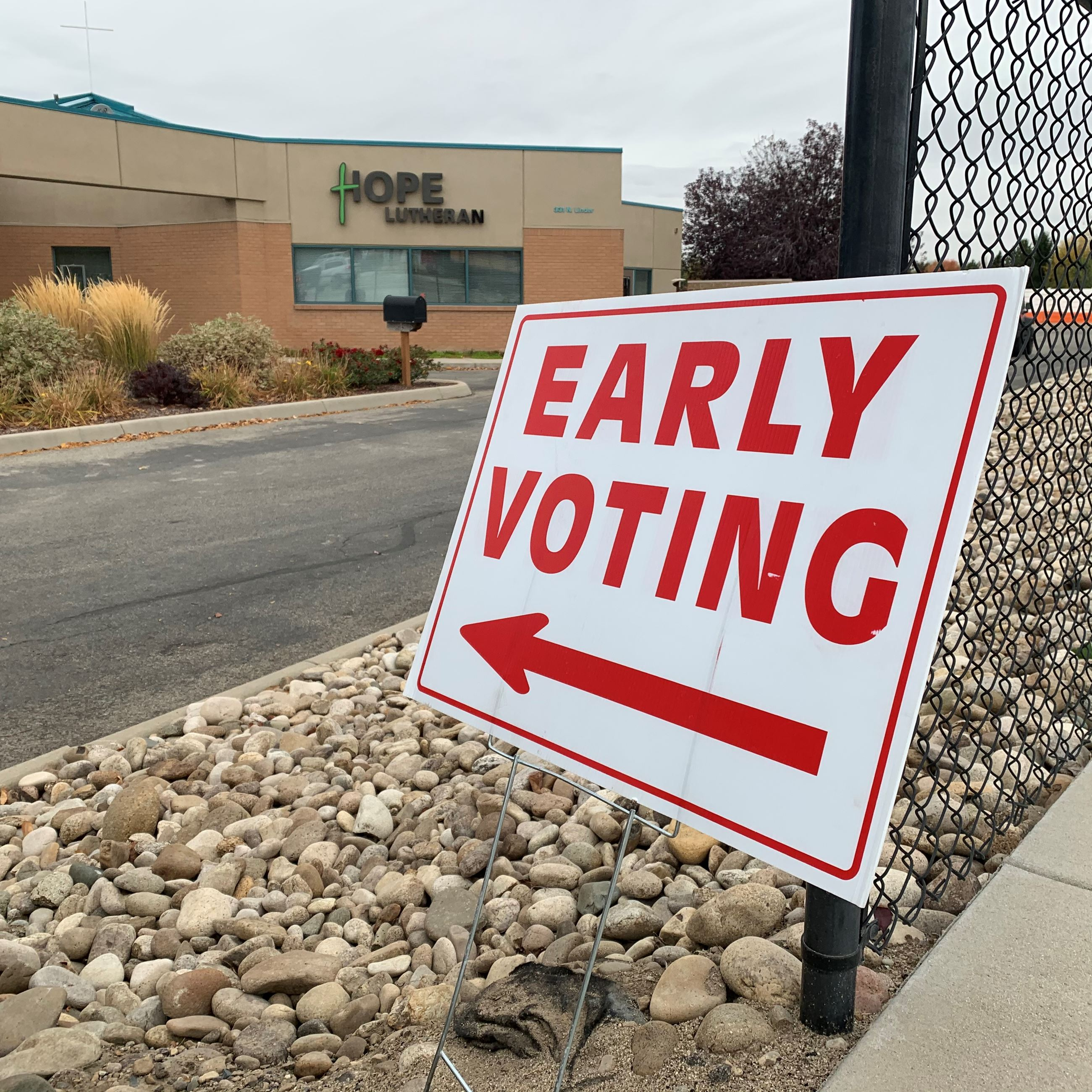 An Early Voting sign points at the Eagle Hope Lutheran Church Building.
