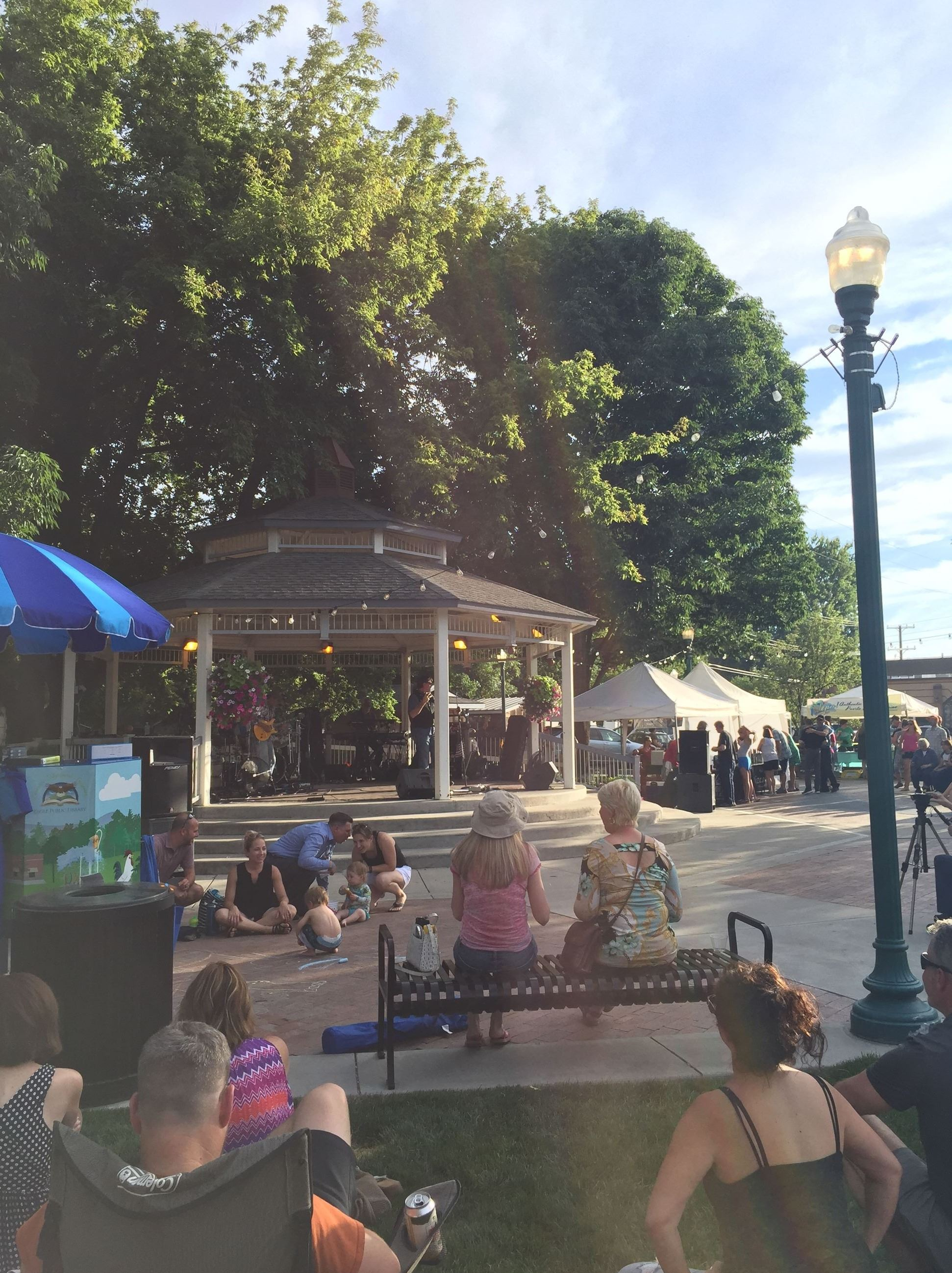 People watching a concert at Heritage Park during the Gazebo Concert Series.