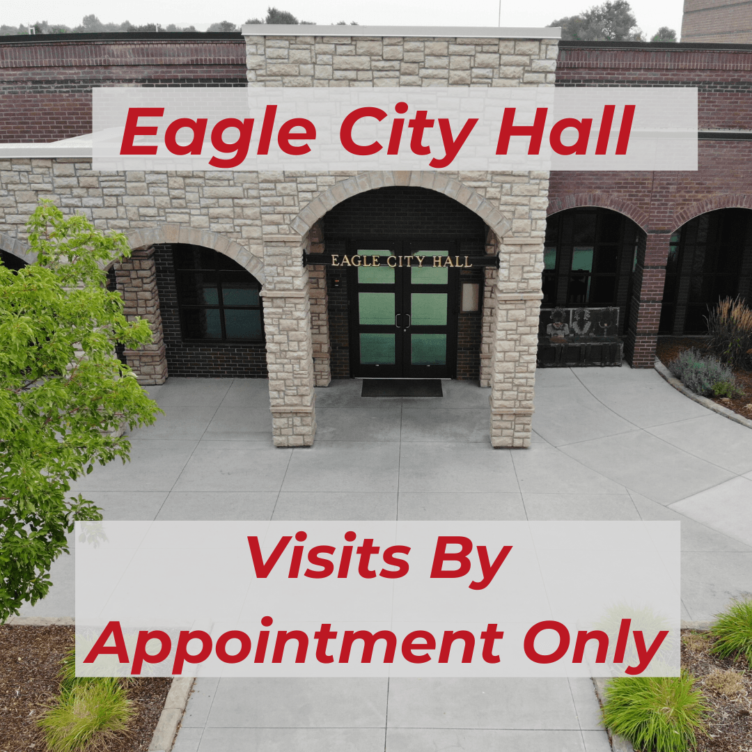 "Eagle city hall front doors with text ""Visits by appointment only"""