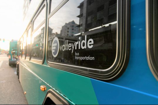 A photograph of the window of a ValleyRide Bus with the ValleyRide logo in the window.